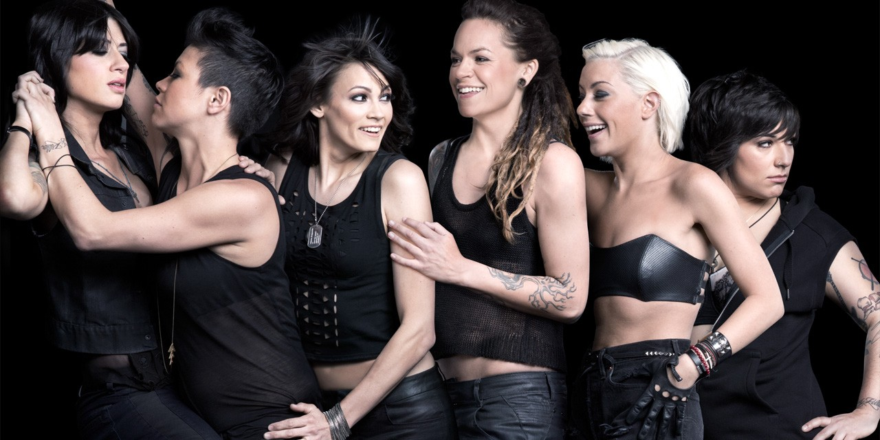 The cast of the L Word, clad in black and smiling together in a promo photo