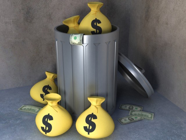 A trash can with money bags