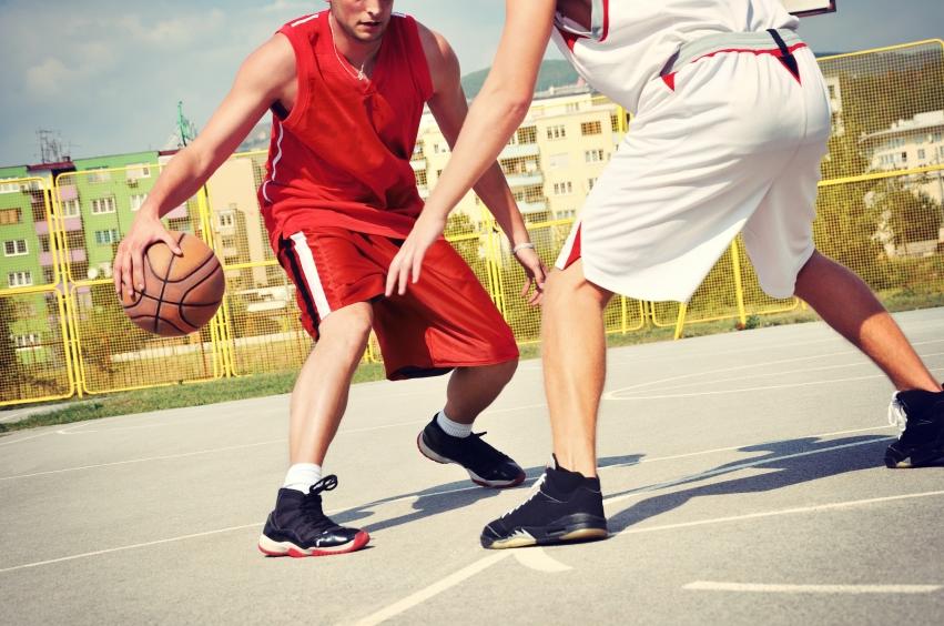 Men play pick-up basketball