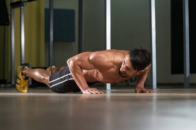 Man performing ab workouts at the gym