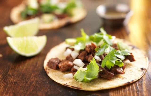 tacos on a wooden surface