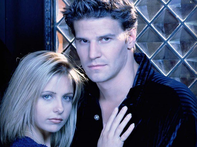 Buffy and Angel posing together