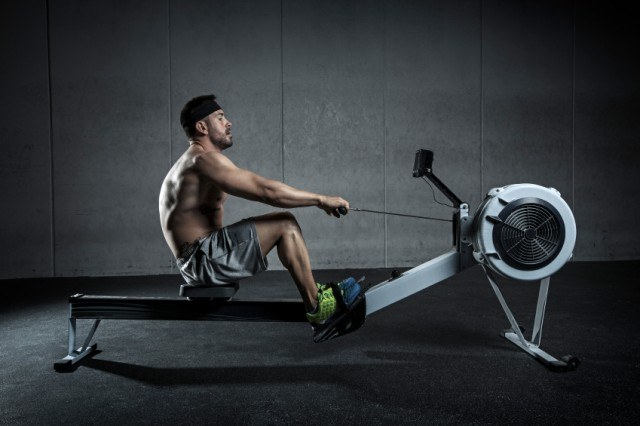 Man on a rowing machine at the gym