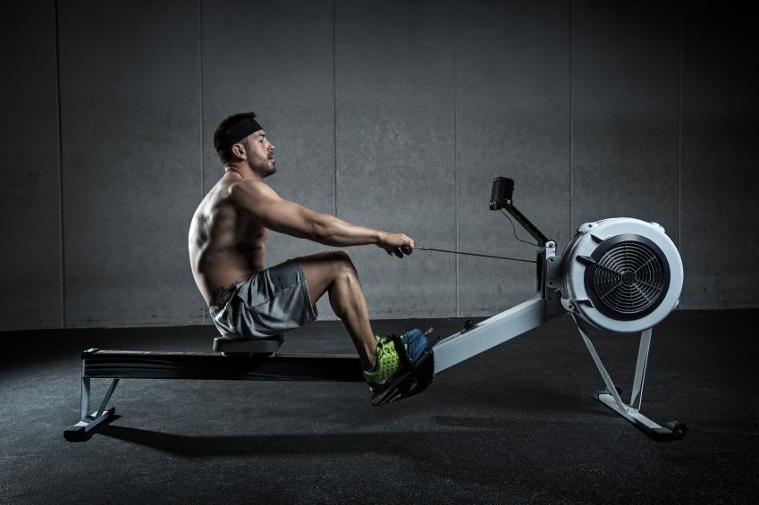 Man using rowing machine