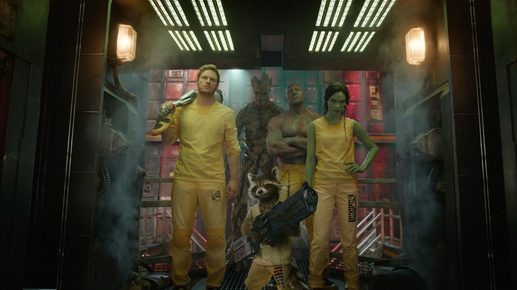 The Guardians wield weapons and stand together in yellow outfits in Guardians of the Galaxy