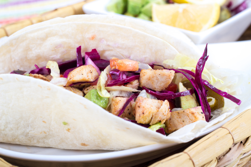 fish tacos with slaw in flour tortillas
