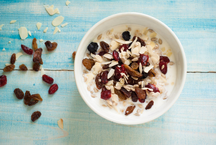 Overhead image of oatmeal with fruit and nuts