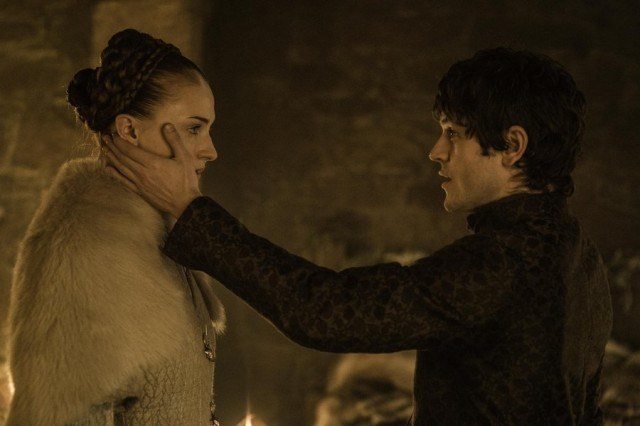 Ramsay puts his hand on Sansa's cheek as they stand facing one another
