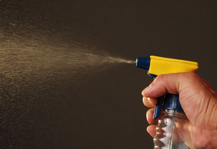 hand with spray bottle