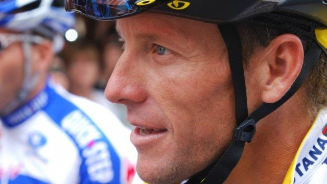 Cyclist Lance Armstrong wearing a helmet