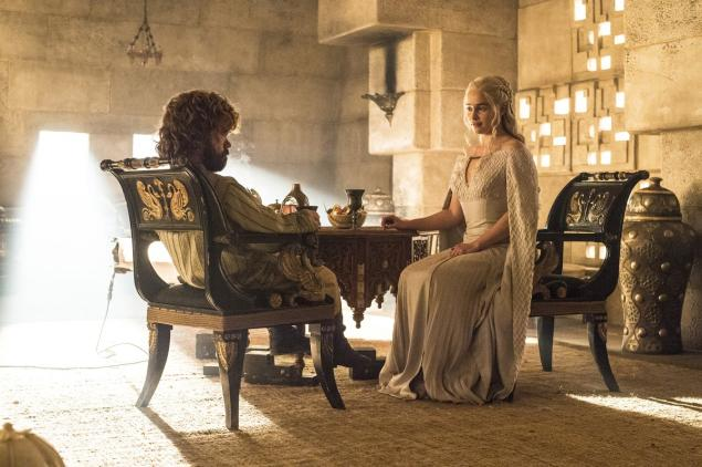 Tyrion and Daenerys sit at a table on Game of Thrones