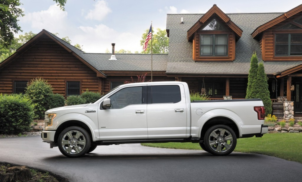 Known for its durability and popularity, a white 2016 Ford F-150 truck sits parked in the driveway