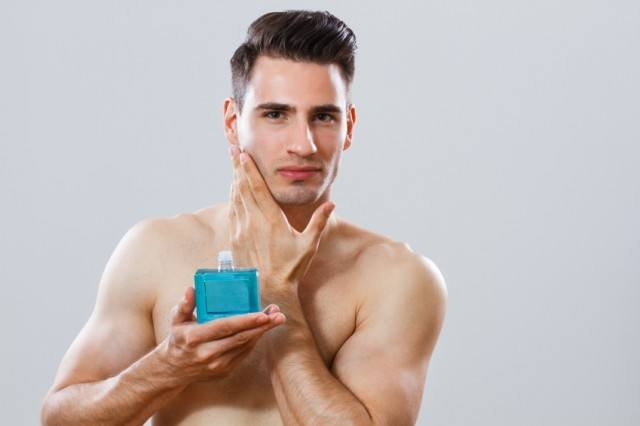 Man holding aftershave