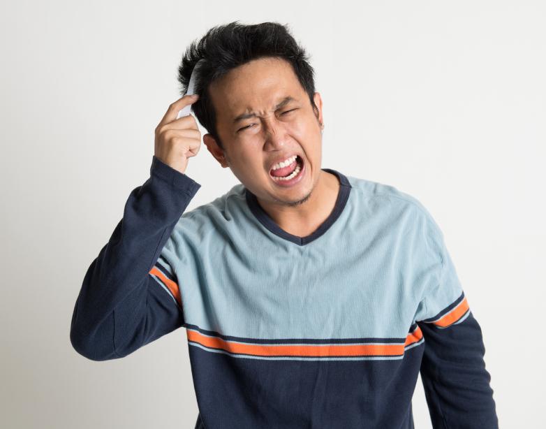 a man brushing his hair