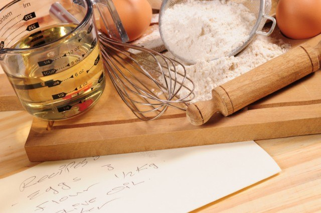 flour, oil, and baking utensils on a cutting board