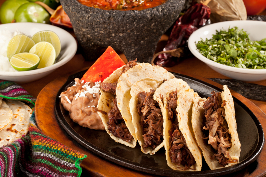 beef tacos served with salsa