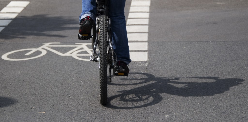 person bicycling on the road