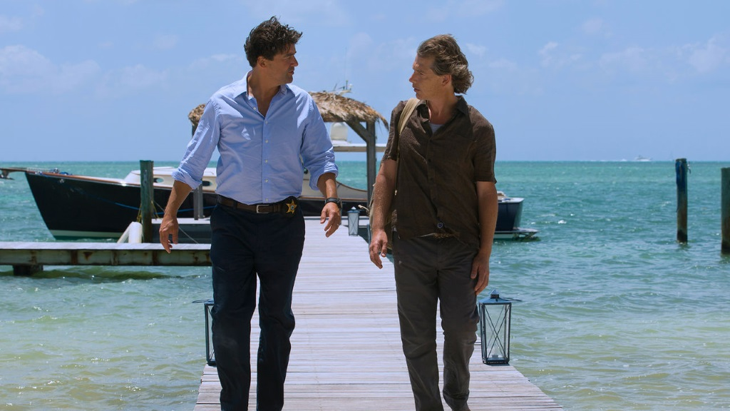 John and Danny Rayburn walk on a dock at their mother's inn.