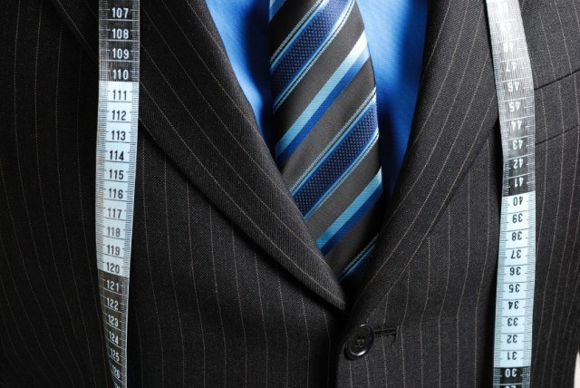 Suit with tape measurer around it