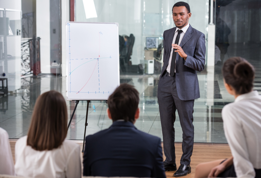 Man giving presentation in front of co-workers