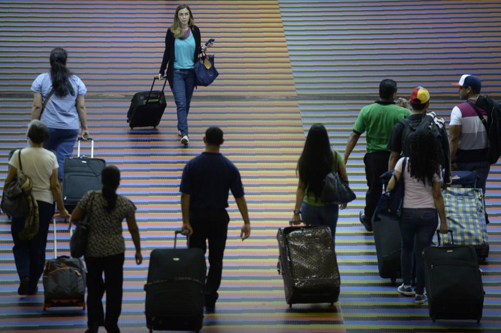 Travelers walking through an airport