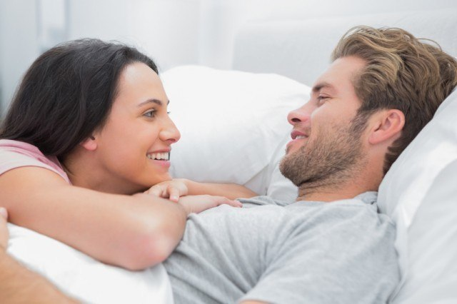Couple talking in bed