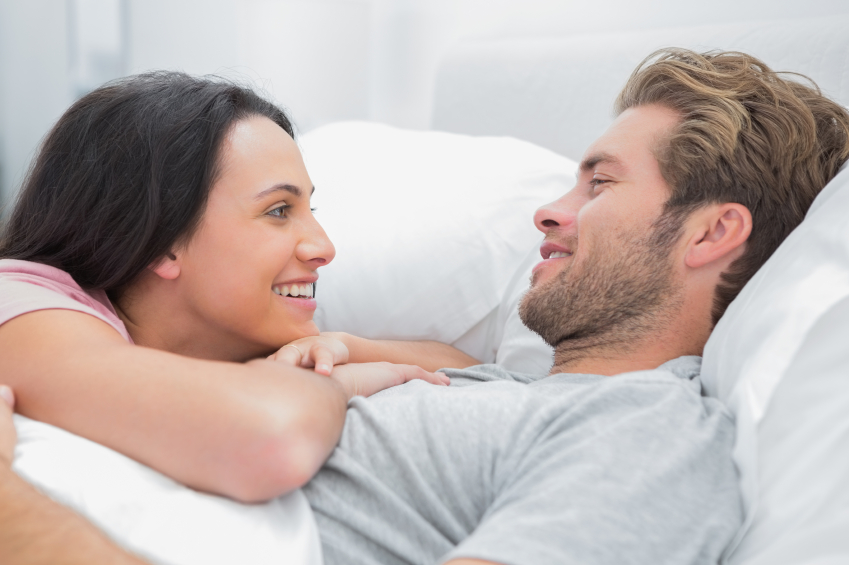 couple cuddling in bed