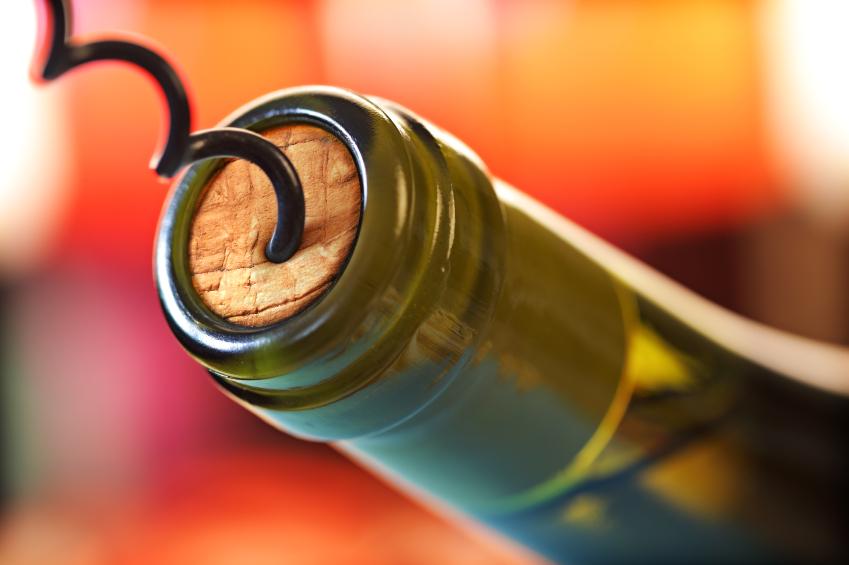 corkscrew opening a bottle of wine