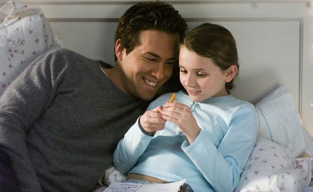 Ryan Reynolds on a bed next to a little girl.