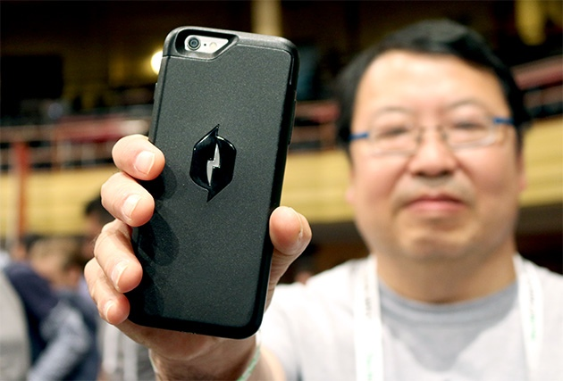 Dr. Robert Lee of Nikola Labs holds one of the first prototypes of the company's smartphone case at TechCrunch Disrupt