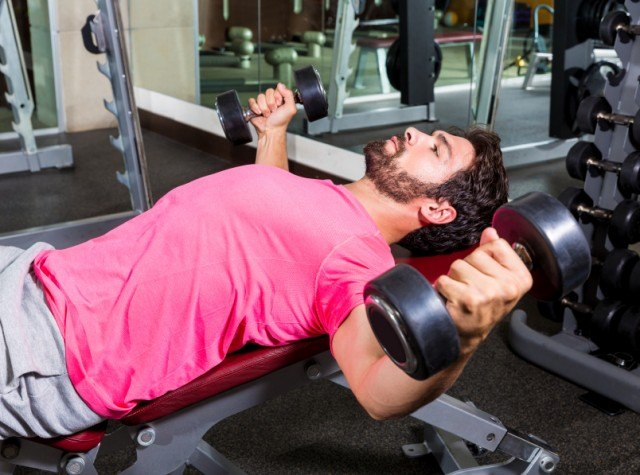 man weight lifting for a bigger chest