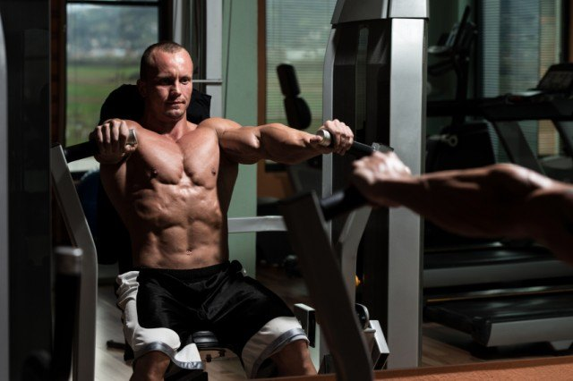 A man doing bench press for total-body workout