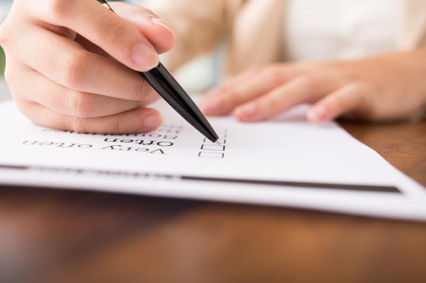Person checking off checklist