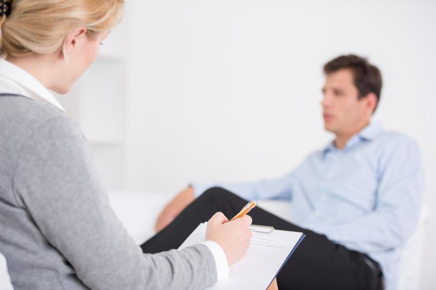 A man talks with a psychologist