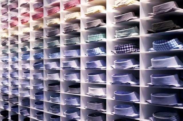 Folded colorful dress shirts in closet