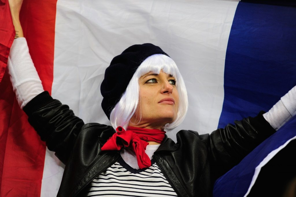 A woman holds the French flag.