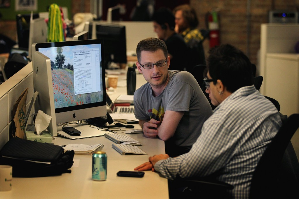 employees sitting at a desk