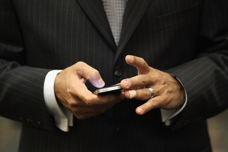 Man's hands on a smartphone.