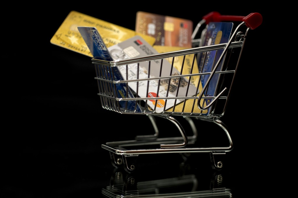 A shopping cart filled with credit cards