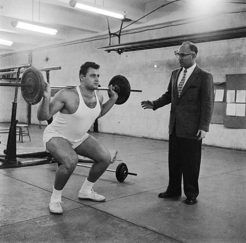 a man weight lifting
