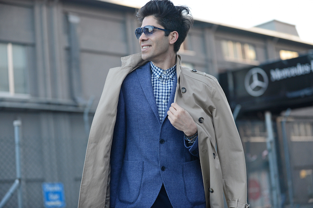 Man in a navy, tweed suit