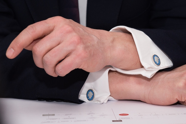 stylish man wearing cufflinks and a suit
