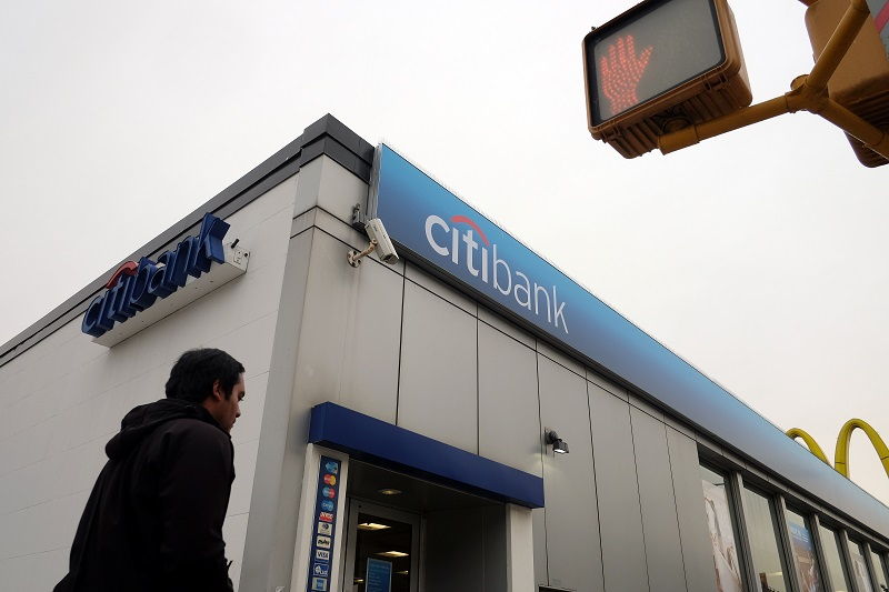 A man walks to a Citibank branch
