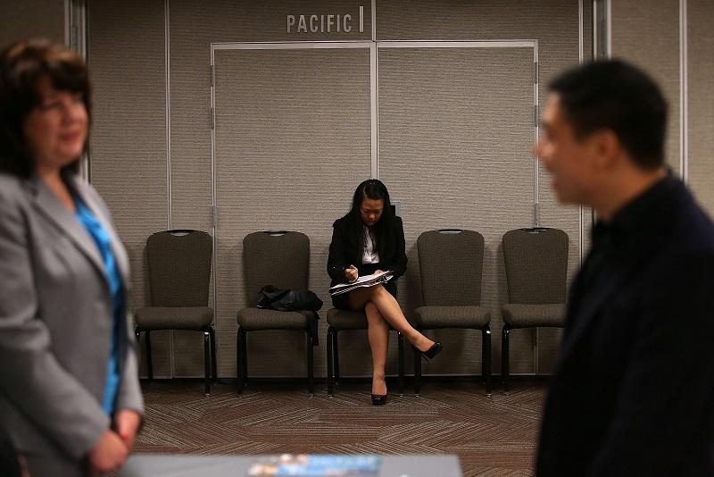 A woman fills out a job application
