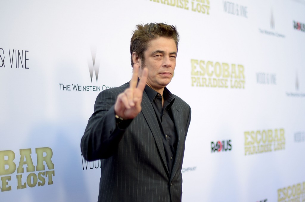 Benicio Del Toro flashes a peace sign on the red carpet