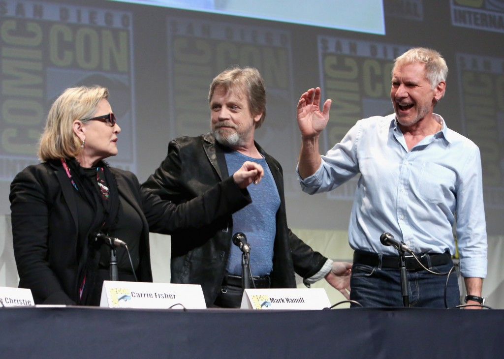 (L-R): Carrie Fisher, Mark Hamill, and Harrison Ford on stage at San Diego Comic-Con