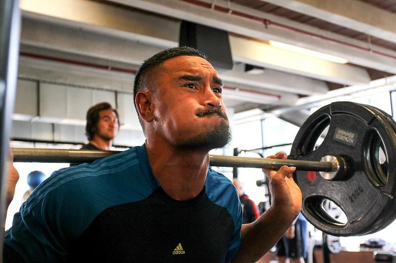 man doing heavy squats