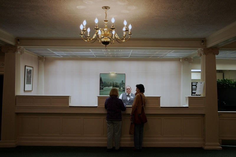 Woman at the front desk of a hotel