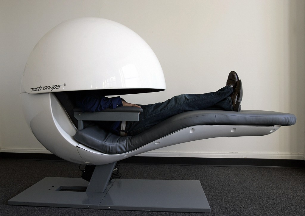 A man secludes himself in a nap pod