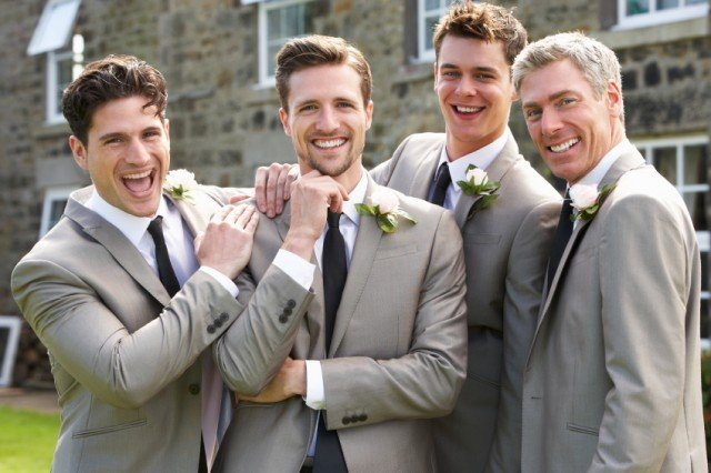 Groomsmen posing for a picture